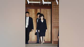 Japan's defense minister visits controversial shrine after Pearl Harbor