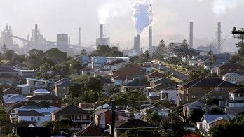 Australian parliament votes to scrap controversial carbon tax