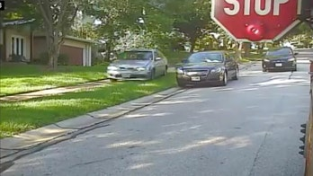 Man nabbed after video shows car driving onto sidewalk to pass stopped school bus