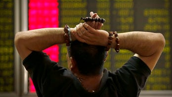 Asian, European stock markets down sharply after China loses all 2015 gains