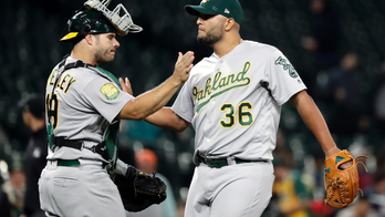 Olson's slam helps A's top Mariners 9-3, close in on Yankees