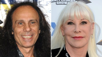 Ronnie James Dio's widow says it was 'very difficult' sending his possessions to auction: 'Some of the shirts still smell of him'