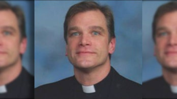 Rainbow-flag burning priest removed from Chicago parish