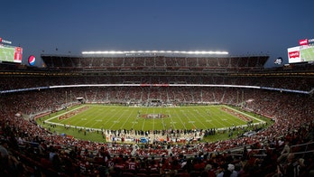 The <i>Other</i> Football: Battle over Super Bowl fields reaches fever pitch