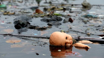 Only a year before Olympics, IOC turns blind eye toward polluted Rio waters