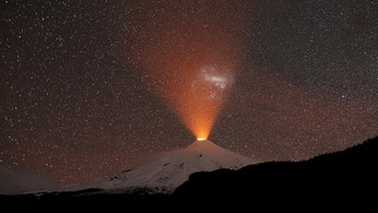 Volcano lights up snowy sky in stunning photo