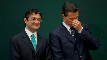 Mexico's Peña Nieto vows transparency but appoints an ally to investigate him