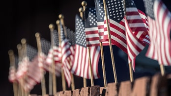 Massachusetts hospital worker helps plant 500 American flags after coronavirus forces Boston to cancel annual display