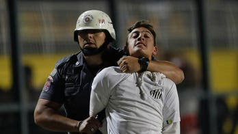 Police clash with soccer fans protesting 3-0 score imposed before match, game abandoned