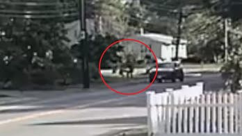 Massachusetts jogger fights off would-be kidnapper in surveillance footage