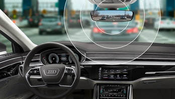 Forget fumbling for change, Audi is making cars that can 'talk' to toll booths