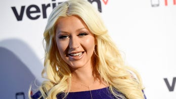 Christina Aguilera gives off classic Hollywood vibes in swimming pool pics: 'Cheers'