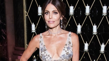 Bethenny Frankel shows off her toned figure during a boating trip: 'Lady in red'