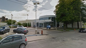 BMW dealership employee charged with attempted murder for allegedly poisoning co-worker
