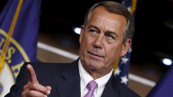 Former House Speaker John Boehner shows off portrait painted by George W. Bush