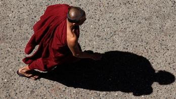 Buddhist monk beats, kills child, 9, during prayer session, authorities say