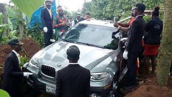 Photo of Nigerian man allegedly being buried in new BMW SUV goes viral