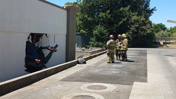 Out of control driver smashes through Taco Bell drive-thru and laundromat wall