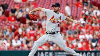 Cardinals rookie's no-hit bid broken up by fire alarm, then Reds