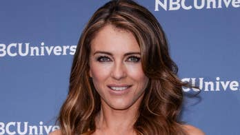 Elizabeth Hurley called out by fans for wearing sexy dress to Thanksgiving dinner with US ambassador