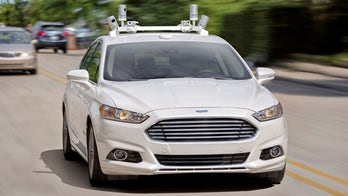 You'll be able to hitch a ride in a self-driving Ford in 2021