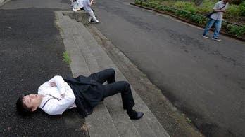 Japan's antidote to overwork: 'inemuri' naps