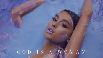 Ariana Grande wears nothing but paint in 'God Is a Woman' cover art