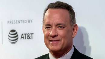 Tom Hanks poses with fan's 'Toy Story' stomach tattoo: 'Howdy partner!'