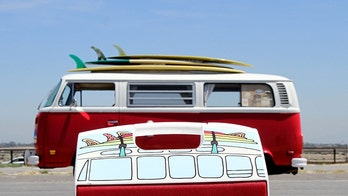 Igloo makes a VW Microbus-shaped cooler with surfboards on top