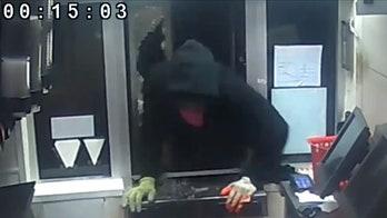KFC bandit seen bashing drive-thru window, popping open registers with screwdriver