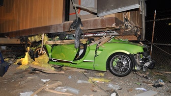 Suspected drunk driver wedges Lamborghini underneath trailer, police say