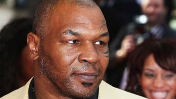 Mike Tyson nearly knocks out trainer in lead-up to Roy Jones Jr. exhibition match