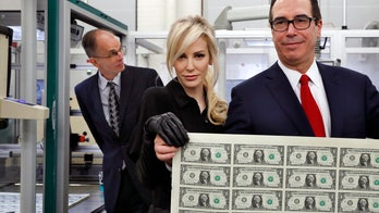 Treasury boss Mnuchin, wife raise eyebrows with big money photo op