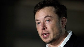Elon Musk thinks humans will have to merge with machines to overcome their 'existential threat'