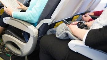Viral video captures heated argument between airline passengers over armrest