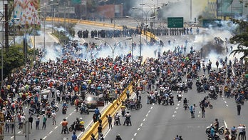 Venezuela protesters throw eggs, objects at president during rally as unrest grows
