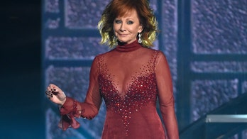 Reba wears infamous red dress at ACM Awards