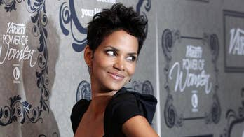 Halle Berry shares sultry throwback photo lying on a bed of strawberries: 'Best berry pun wins'