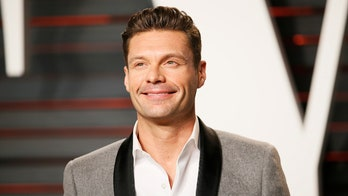 Ryan Seacrest falls out of his chair during broadcast of 'Live with Kelly and Ryan'