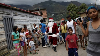 Venezuelan children acclimating to the idea of a meager, bankrupt Santa