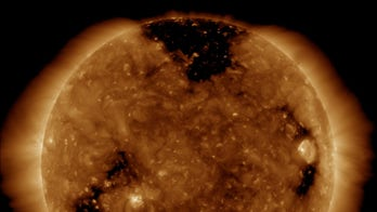 Hole in Sun's atmosphere amps up Northern Lights