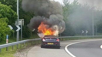 Driver trapped in burning BMW after engine caught fire, brakes failed. Cause unclear