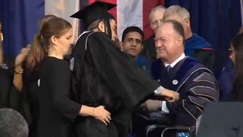 Paralyzed Georgetown linebacker walks across stage at graduation