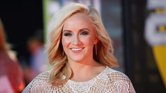 Olympic gold medalist Nastia Liukin performs acrobatic first pitch before St. Louis Cardinals game