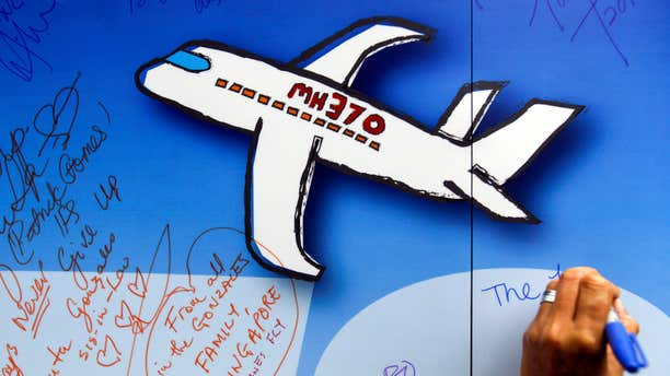 In this March 6, 2016, file photo, well wishes are written on a wall of hope during a remembrance event for the ill fated Malaysia Airlines Flight 370 in Kuala Lumpur, Malaysia.