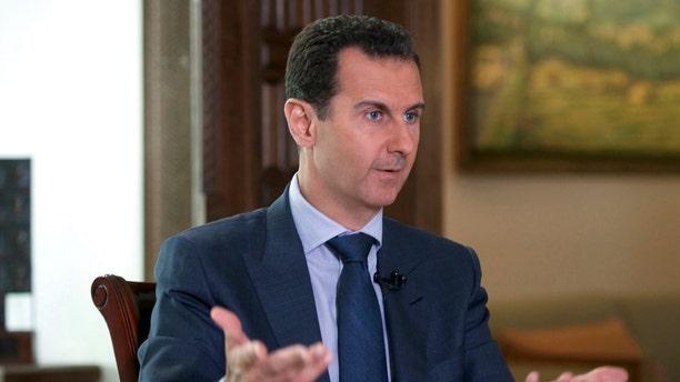 FILE-- Sept. 21, 2016: Syrian President Bashar Assad