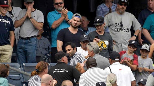 Baseball fans react after a 2-year-old girl is hit with a foul ball during a Wednesday game at Yankee Stadium.