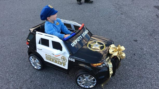 Cohen, 3, in his new toy car.