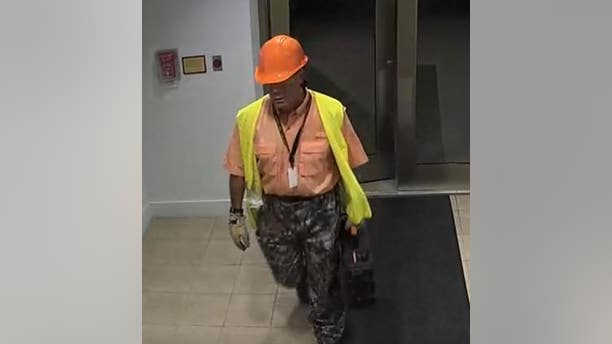 American University officials say the man pictured here placed Confederate flag posters with cotton on them in four buildings.