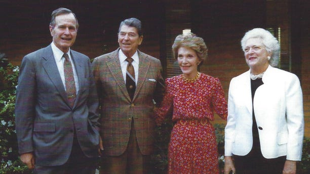 George and Barbara Bush with Nancy and Ronald Reagan outside the Reagan's Bel Air residence in Los Angeles, California, February 25, 1992.
